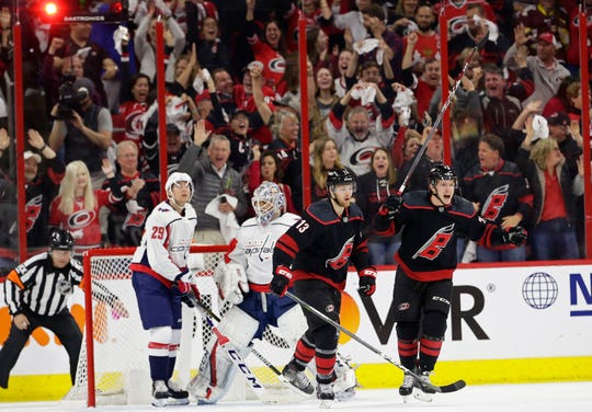 Hurricanes' Warren Foegele (13) and Brock McGinn celebrate Foegele's goal against the Capitals during the first period of Game 3 on Monday.