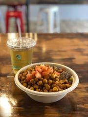 Curry chicken with turmeric rice and fried chick peas with house-made flavored tea at YumVillage.