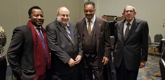 From Left to right: Columnist Bankole Thompson, Detroit News publisher and editor Jonathan Wolman, Rev Jesse Jackson and Rabbi emeritus Daniel Syme of Temple Beth El at the 2018 Let Freedom Ring Award Ceremony at Cobo Convention Hall.