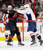 Washington Capitals forward Alex Ovechkin, right, punches Carolina Hurricanes rookie Andrei Svechnikov during the first period of Game 3 of an NHL playoff series on Tuesday night Raleigh, N.C.