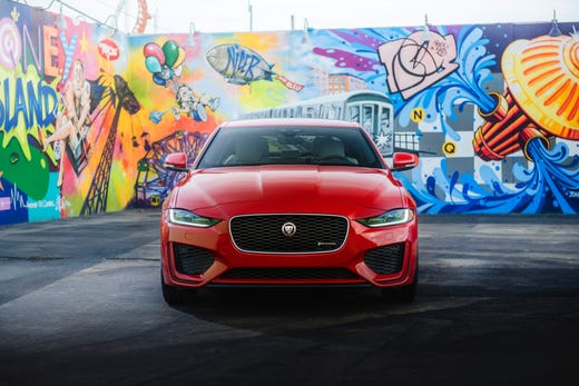 Befitting the Jaguar's sleek, purposeful exterior design, wardrobe changes are small. The grille has been widened up front and the headlamps and air intakes leaned to give the car a more athletic stance.