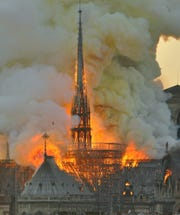 "In this image made available on Tuesday April 16, 2019 flames and smoke rise from the blaze at Notre Dame cathedral in Paris, Monday, April 15, 2019. An inferno that raged through Notre Dame Cathedral for more than 12 hours destroyed its spire and its roof but spared its twin medieval bell towers, and a frantic rescue effort saved the monument's ""most precious treasures,"" including the Crown of Thorns purportedly worn by Jesus, officials said Tuesday."