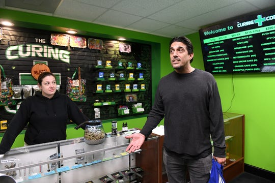 Amy McKinnon-Glun, left, is team leader at the Curing Corner, which has sued the state to extend the deadline under which licensed dispensaries can buy from caregivers. Jake Abraham owns the Sticky Ypsi dispensary in Ypsilanti.