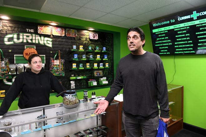 Amy McKinnon-Glun, left, is team leader at the Curing Corner, which has sued the state of Michigan to extend the deadline under which licensed dispensaries can buy from caregivers. Jake Abraham owns the Sticky Ypsi dispensary in Ypsilanti. (Photo: Robin Buckson, The Detroit News)