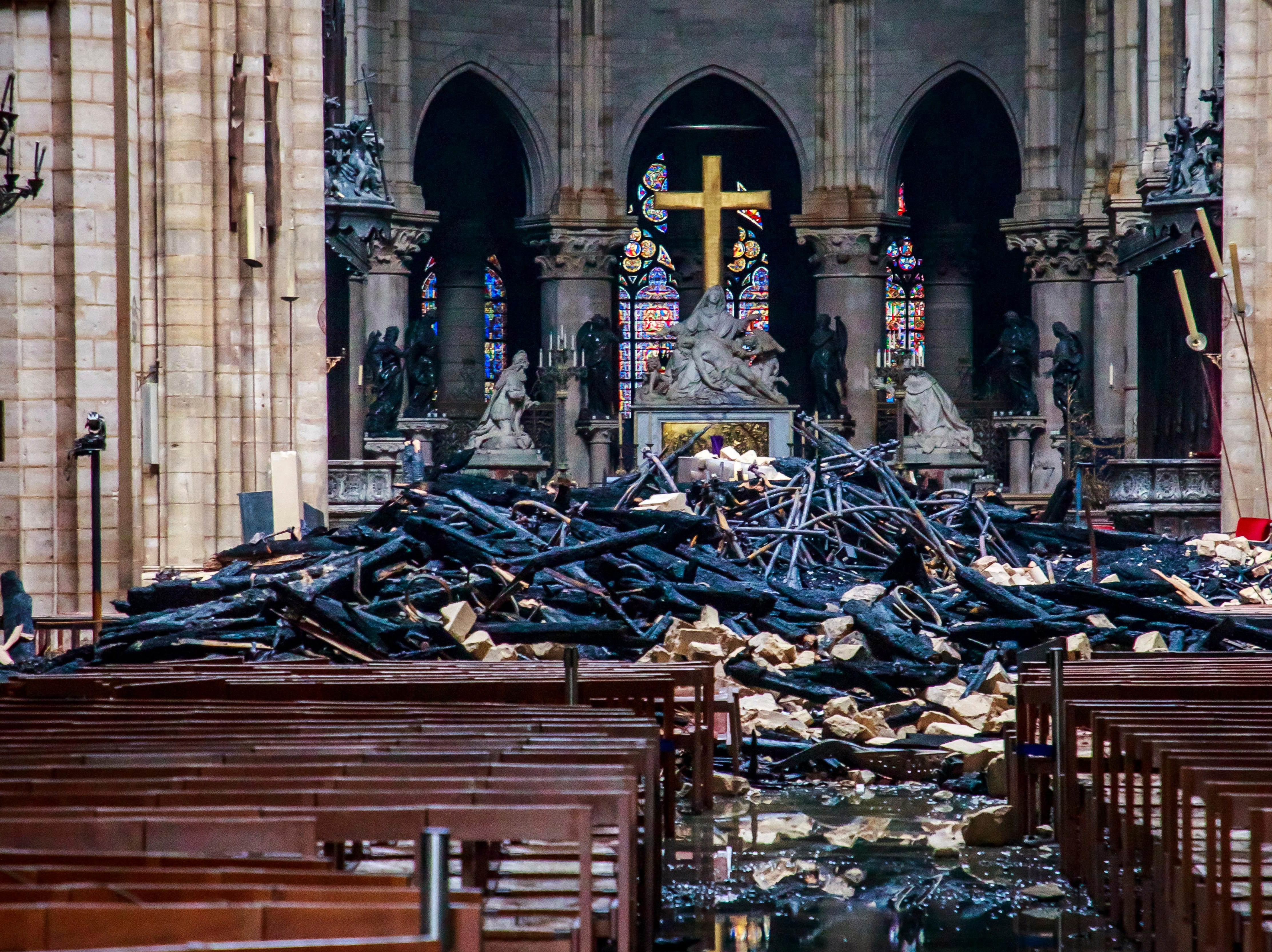 A hole is seen in the dome inside Notre Dame cathedral in Paris, Tuesday, April 16, 2019. Firefighters declared success Tuesday in a more than 12-hour battle to extinguish an inferno engulfing Paris' iconic Notre Dame cathedral that claimed its spire and roof, but spared its bell towers and the purported Crown of Christ.