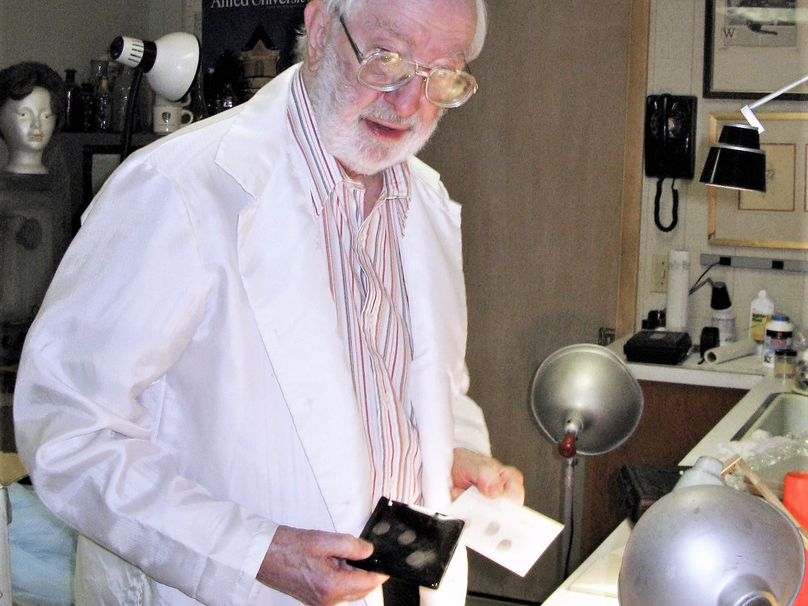 Herbert MacDonell, working in the laboratory at his South Corning home, demonstrates a fingerprinting technique he perfected.