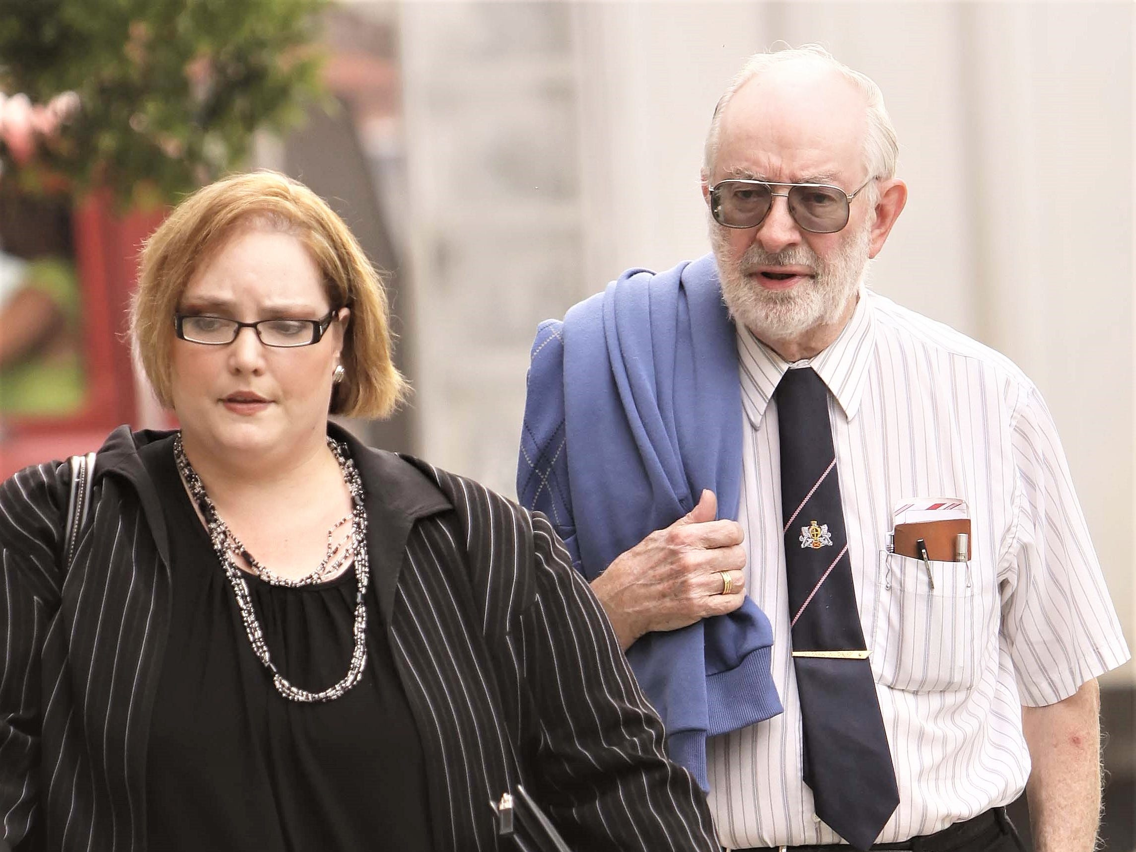Herbert MacDonell of Corning, a pioneer in blood stain analysis, and associate Anita Zannin head to Tioga County Court during one of Cal Harris's murder trials.