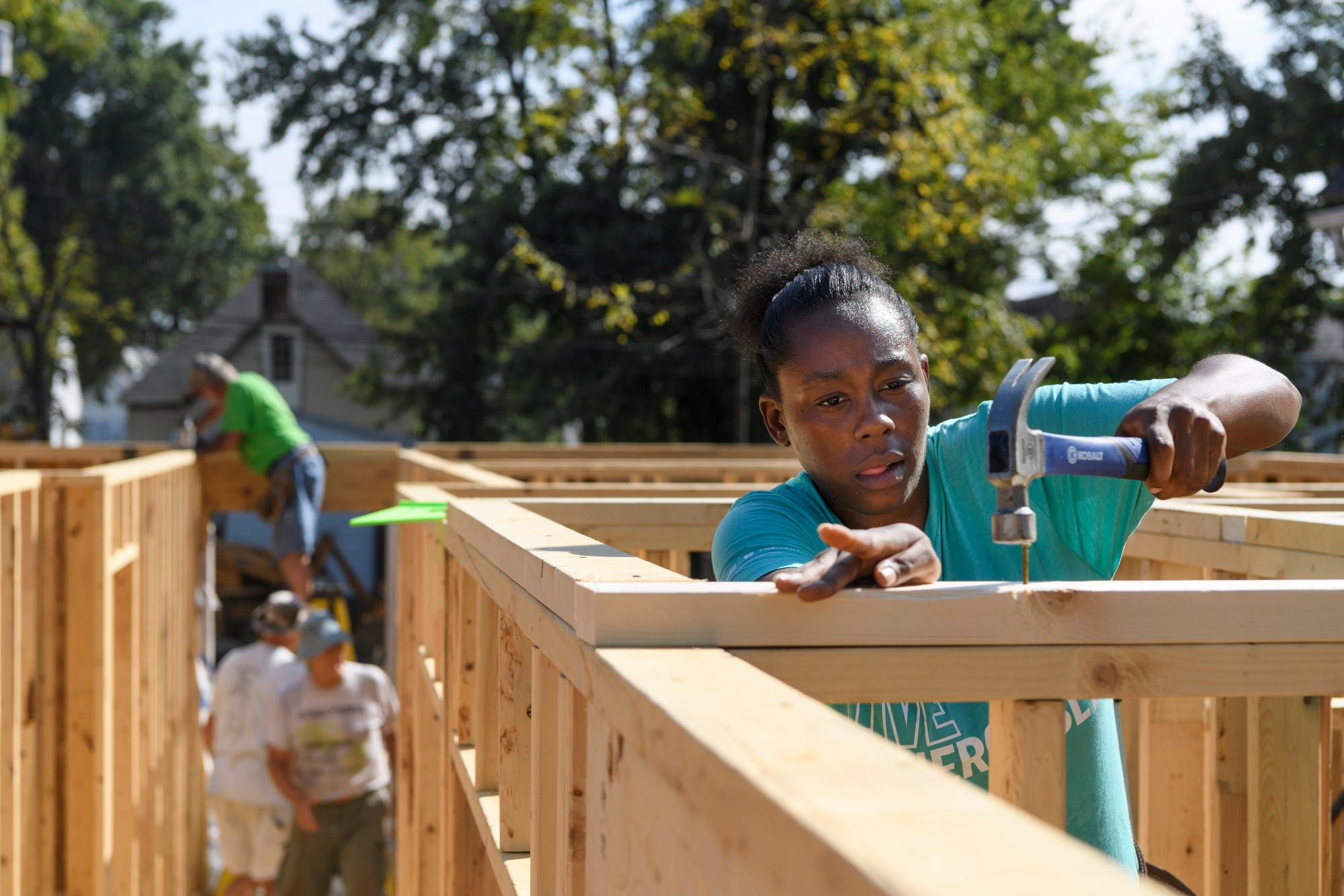 """Tamisha Dilworth builds walls for her future home with the help of Habitat for Humanity's Core Crew builders and other future homeowners needing """"sweat equity"""" hours as the sun beats down on them, Tuesday morning, Oct. 2, 2018. Every future homeowner has to secure 300 """"sweat equity"""" hours through a combination of attending homeowner education courses, community service, physical labor through home building and working in Habitat's ReStore."""