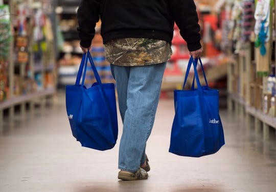 """Edward Goodlow fills the free bags from Anthem with groceries while shopping at Ruler Foods, Tuesday, April 16, 2019. Goodlow was taking advantage of the new """"Feeding the Promise Zone"""" program that uses the TED Trolley to transport individuals living in and around Garfield Commons in Jacobsville to pick up groceries once a week."""