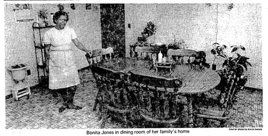 """Bonita """"Bonnie"""" Jones stands in her dining room March 25, 1985. Bonita and her husband Norman where the first to receive a Habitat for Humanity home in Evansville, Indiana."""