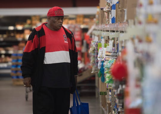 """Robert Meriweather shops at Ruler Foods Tuesday, April 16, 2019. Meriweather was taking advantage of the new """"Feeding the Promise Zone"""" program that uses the TED Trolley to transport individuals living in and around Garfield Commons in Jacobsville to pick up groceries once a week. """"We needed this program,"""" he said."""