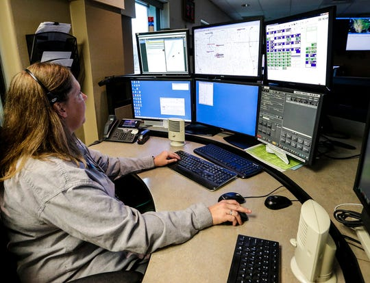 Amy Fideler, a dispatch supervisor at the Fond du Lac County Communications Center, looks over screens associated with the county's new Smart911 system Tuesday, April 16, 2019 at the Fond du Lac County Communications Center.