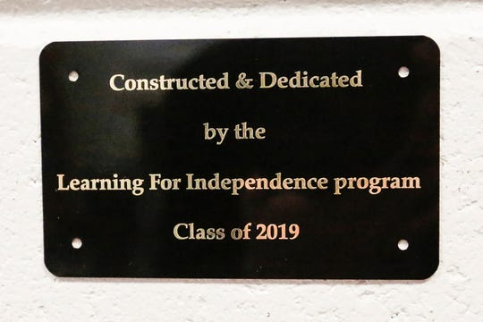 A plaque dedicating a bench made by the Learning For Independence program 2019 graduates is mounted with the bench Thursday, February 28, 2019 at Moraine Park Technical College where the class is held. The bench is installed in the B wing of MPTC. Doug Raflik/USA TODAY NETWORK-Wisconsin