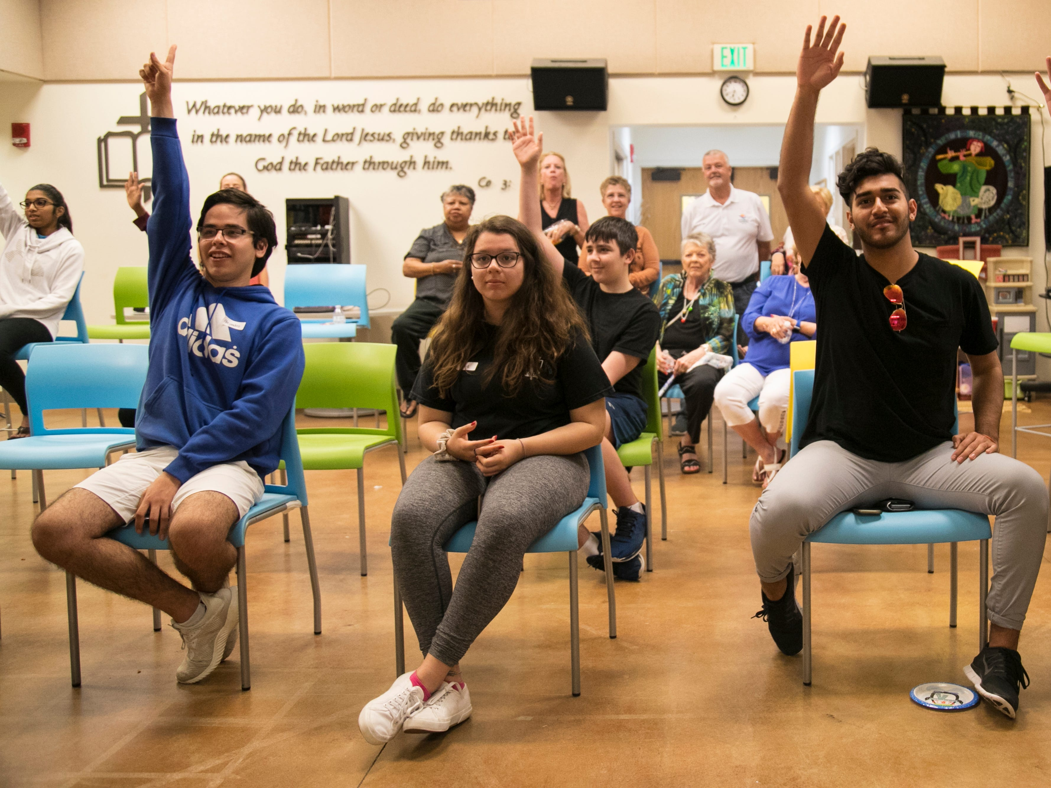 Alejandro Hernandez, left, Lisa Palamo, Marcos Damian-Noyola and Bryan Estrada, right, were among the teens and adults who came to Anna Barry's trivia fundraiser for the Student Alliance on Mental Illness in December 2018 in Naples.
