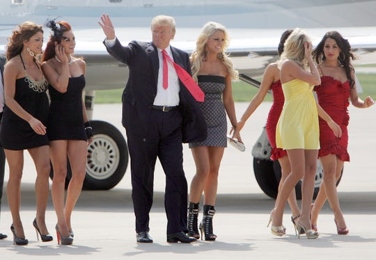 "Donald Trump, the new owner of World Wrestling Entertainment's ""Monday Night RAW,"" and several WWE Divas appeared for a press conference at the Executive Air Terminal at Green Bay Austin Straubel International Airport in Ashwaubenon on June 22, 2009."
