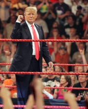 "As the new owner of World Wrestling Entertainment's ""Monday Night RAW,"" Donald Trump gets cheers from the crowd on June 22, 2009, during a live show of ""RAW"" at the Resch Center in Ashwaubenon. Trump returns to the Resch Center next week as president looking ahead to re-election in 2020."