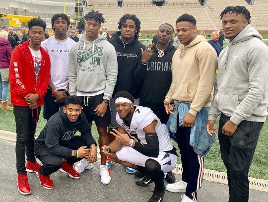 Clemson players gather around former Clemson quarterback Kelly Bryant (7) after the Missouri spring game Saturday.