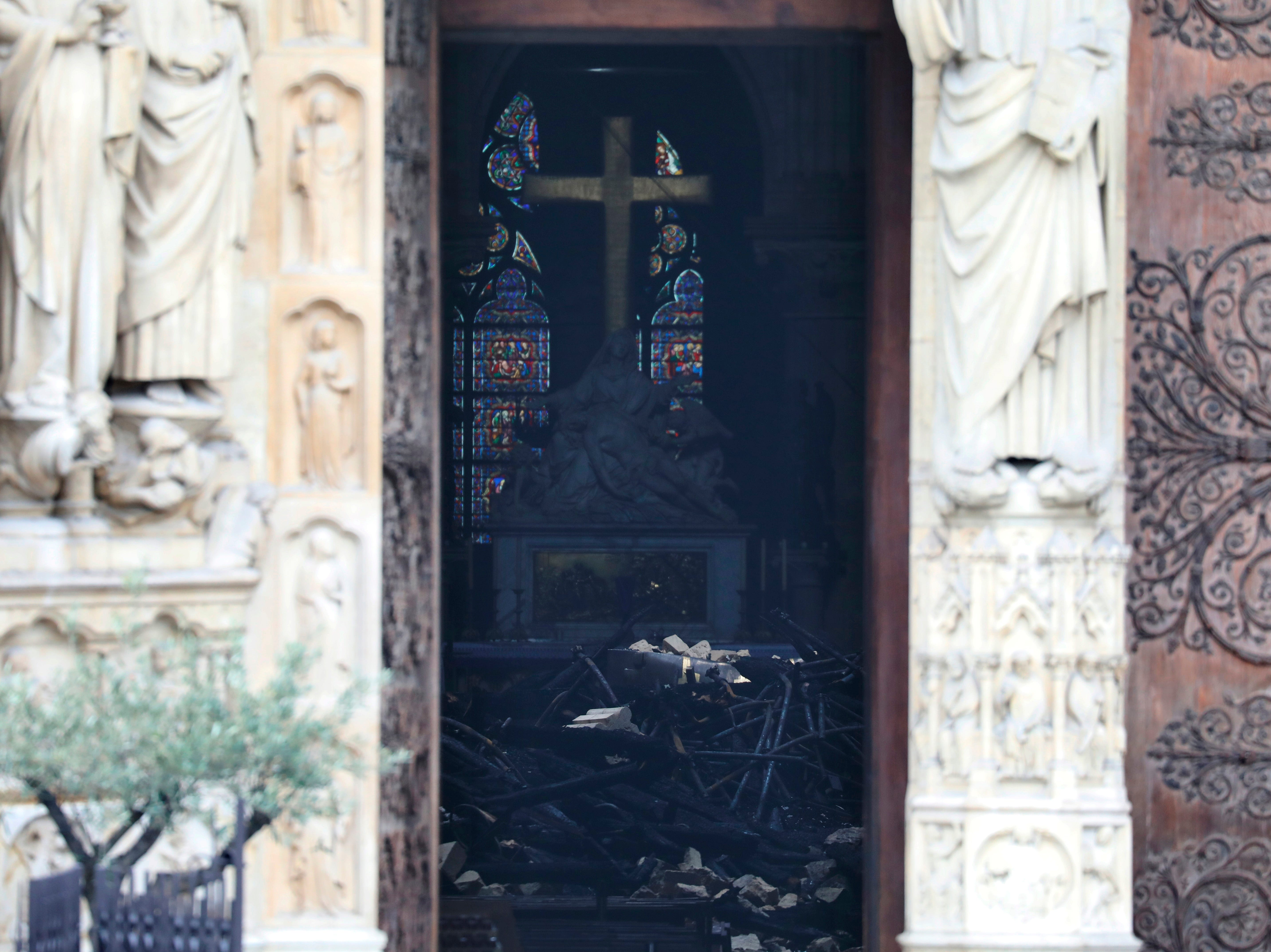 This picture shows charred debris inside Notre Dame cathedral Tuesday April 16, 2019. Firefighters declared success Tuesday morning in an over 12-hour battle to extinguish an inferno engulfing Paris' iconic Notre Dame cathedral that claimed its spire and roof, but spared its bell towers. (Ludovic Marin via AP)
