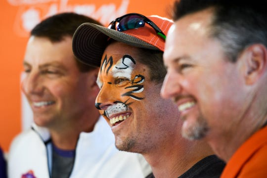 Craig Kilgore takes a photo with Clemson football coach Dabo Swinney and baseball coach Monte Lee during the Growl & Prowl at Fluor Field Monday, April 15, 2019.