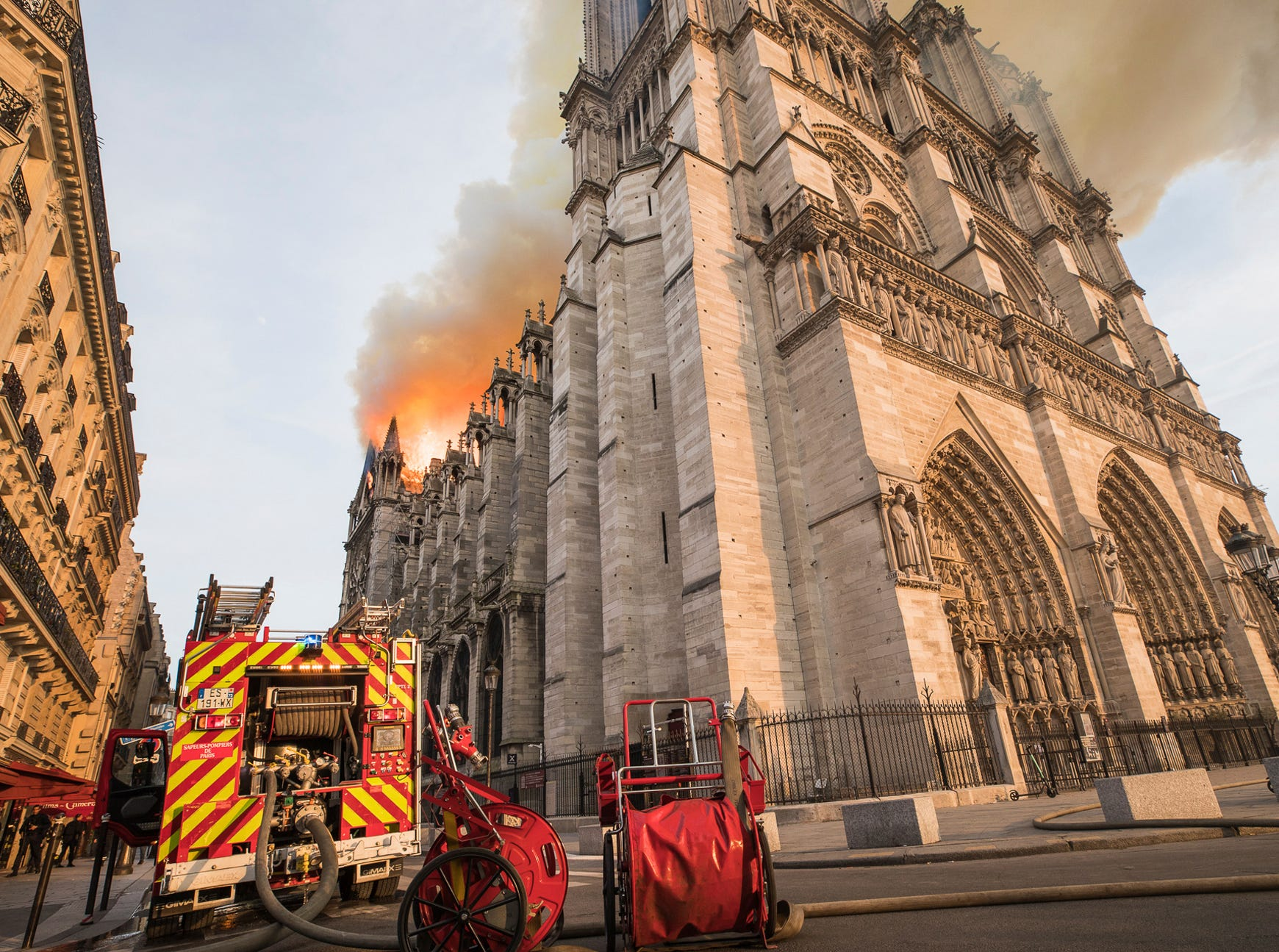 This photo provided Tuesday April 16, 2019 by the Paris Fire Brigade shows a fire brigade truck parked by the burning Notre Dame cathedral, Monday April 15, 2019. Experts assessed the blackened shell of Paris' iconic Notre Dame Tuesday morning to establish next steps to save what remains after a devastating fire destroyed much of the cathedral that had survived almost 900 years of history. (Benoit Moser, BSPP via AP)