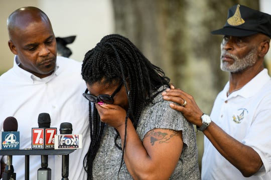 Sharon Mathis, grandmother of one-year-old Xena Norman, is overcome with emotion during a press conference with other family members of Norman outside of the Spartanburg County Courthouse Tuesday, April 16, 2019.