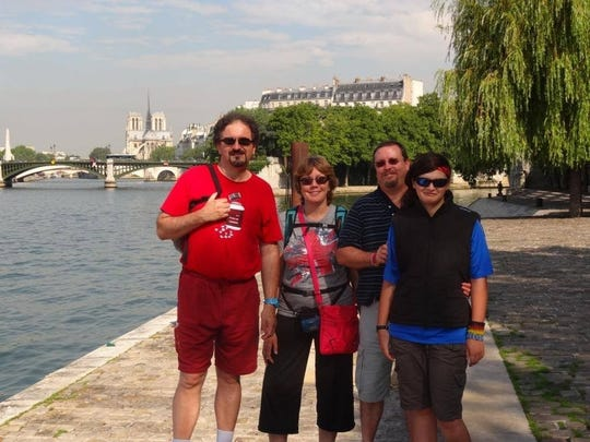 Derrick and Sandrine Howle, right, with relatives and the Notre Dame in the background