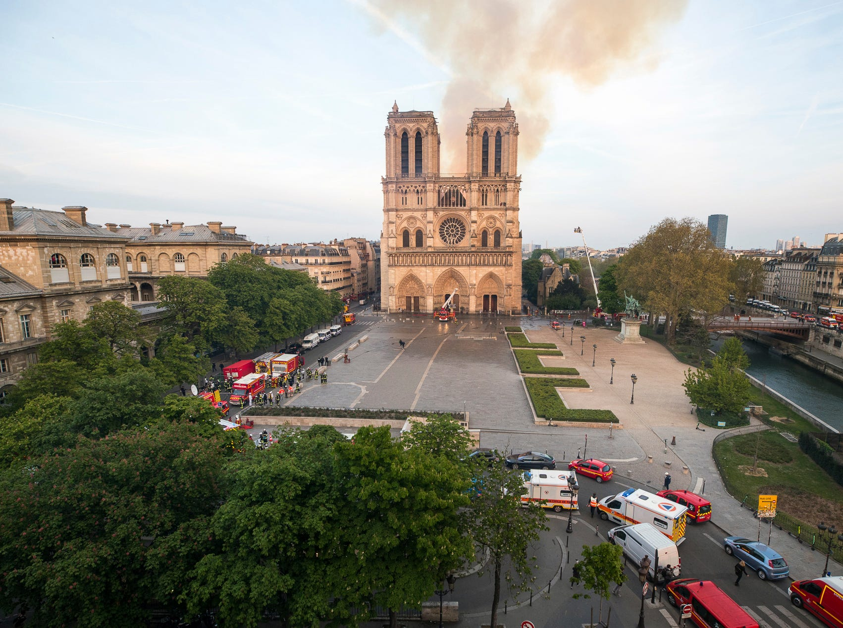 This photo provided Tuesday April 16, 2019 by the Paris Fire Brigade shows fire fighters working at the burning Notre Dame cathedral, Monday April 15, 2019. Experts assessed the blackened shell of Paris' iconic Notre Dame Tuesday morning to establish next steps to save what remains after a devastating fire destroyed much of the cathedral that had survived almost 900 years of history.