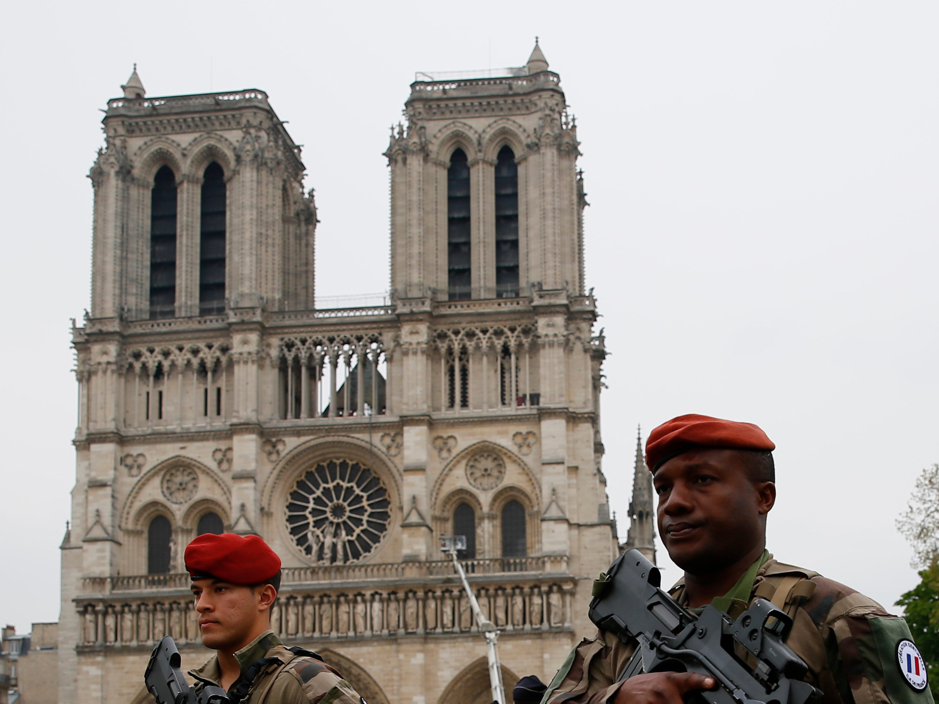 Soldiers patrol in front of Notre Dame cathedral Tuesday April 16, 2019 in Paris. Firefighters declared success Tuesday in a more than 12-hour battle to extinguish an inferno engulfing Paris' iconic Notre Dame cathedral that claimed its spire and roof, but spared its bell towers. (AP Photo/Francois Mori)