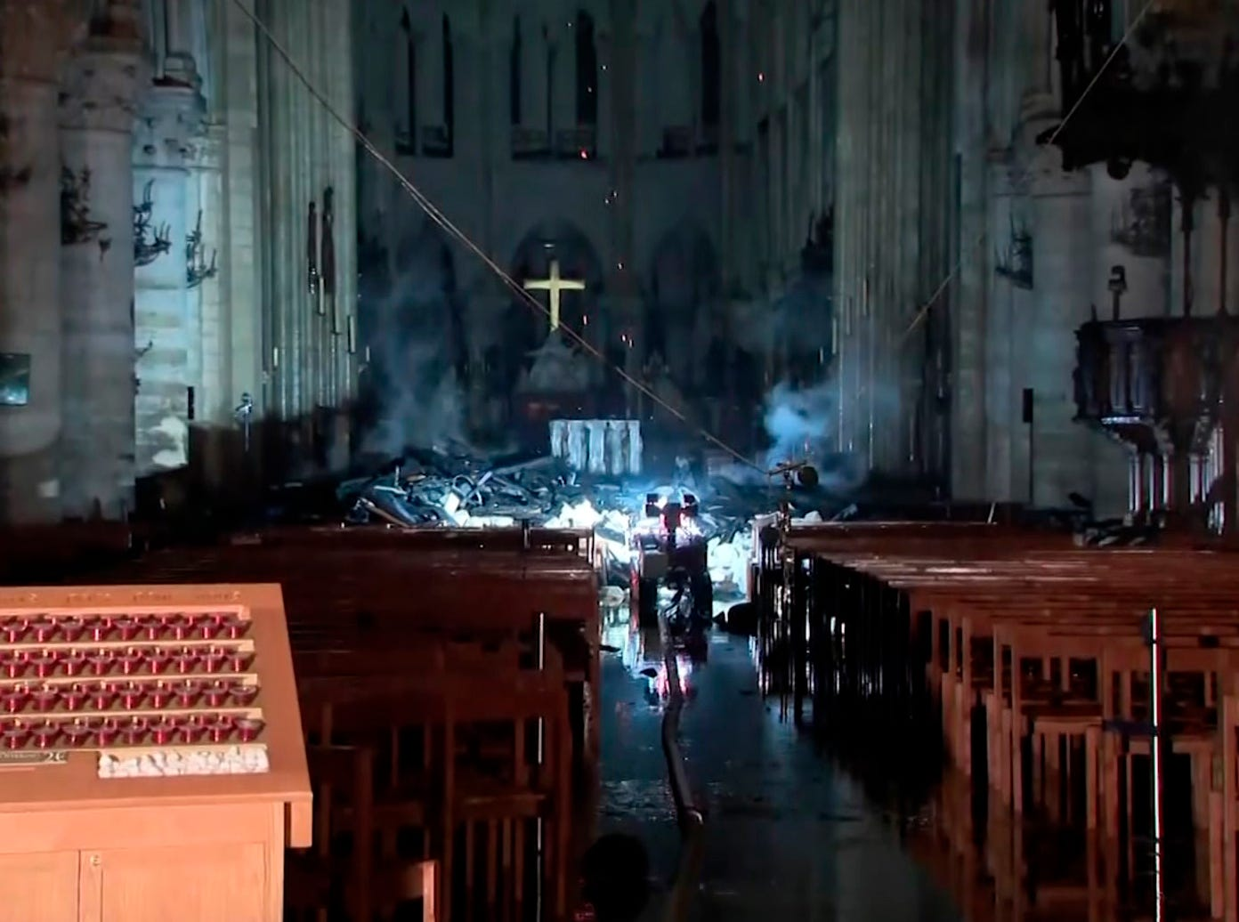 This image taken from France Televisions video shows the fire damage inside the Notre Dame cathedral in Paris, Monday April 15, 2019.  Firefighters declared success Tuesday morning in an over 12-hour battle to extinguish an inferno engulfing Paris' iconic Notre Dame cathedral that claimed its spire and roof, but spared its bell towers. (France Televisions via AP)