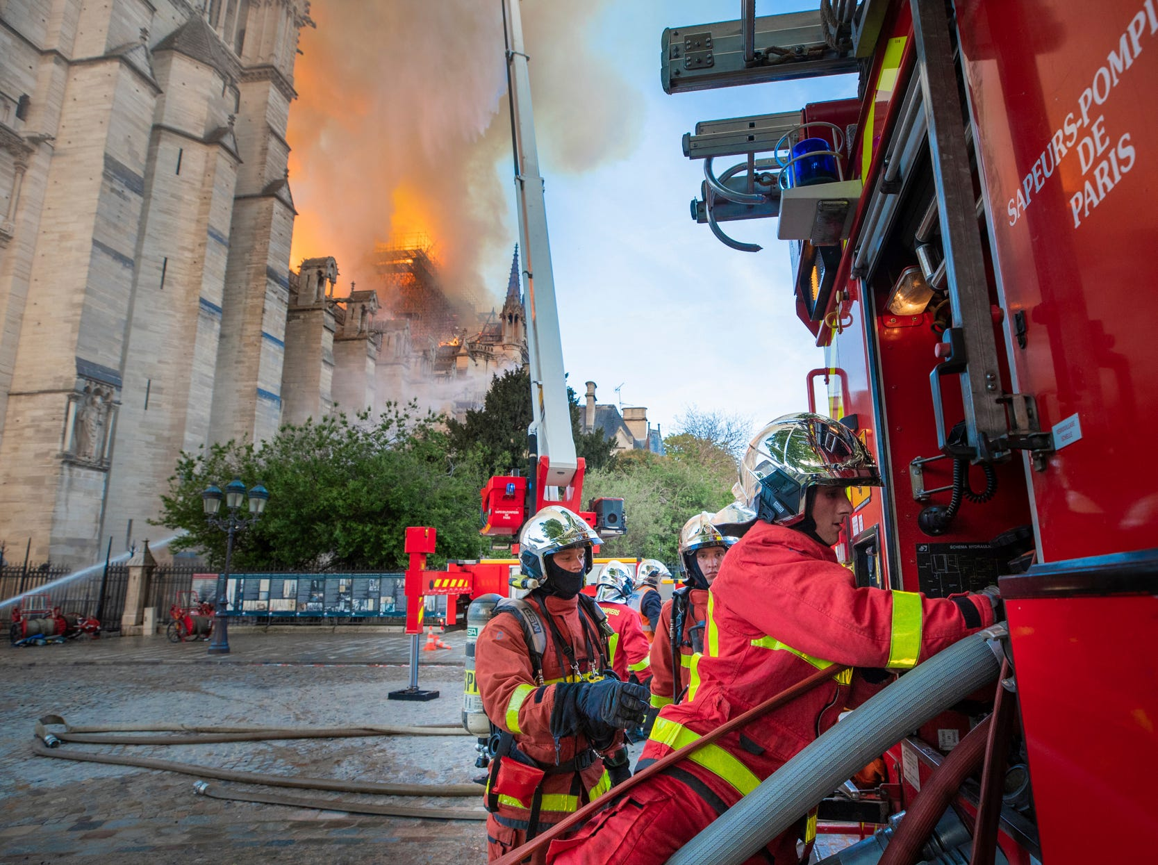 This photo provided Tuesday April 16, 2019 by the Paris Fire Brigade, shows fire fighters working at the burning Notre Dame cathedral, Monday April 15, 2019. Experts assessed the blackened shell of Paris' iconic Notre Dame Tuesday morning to establish next steps to save what remains after a devastating fire destroyed much of the cathedral that had survived almost 900 years of history. (Benoit Moser, BSPP via AP)