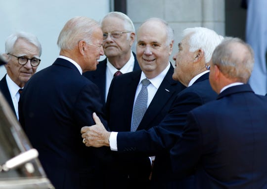 """Joe Biden greets people in front of Summerall Chapel before the start of former U.S. Sen. Ernest """"Fritz"""" Hollings' funeral on The Citadel campus Tuesday, April 16, 2019, in Charleston, S.C. Biden delivered one of the eulogies for his former Senate colleague."""