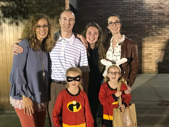 Tonya and Andy Nelson with daughters Mary Grace, Caroline, Charis and Naomi last October.