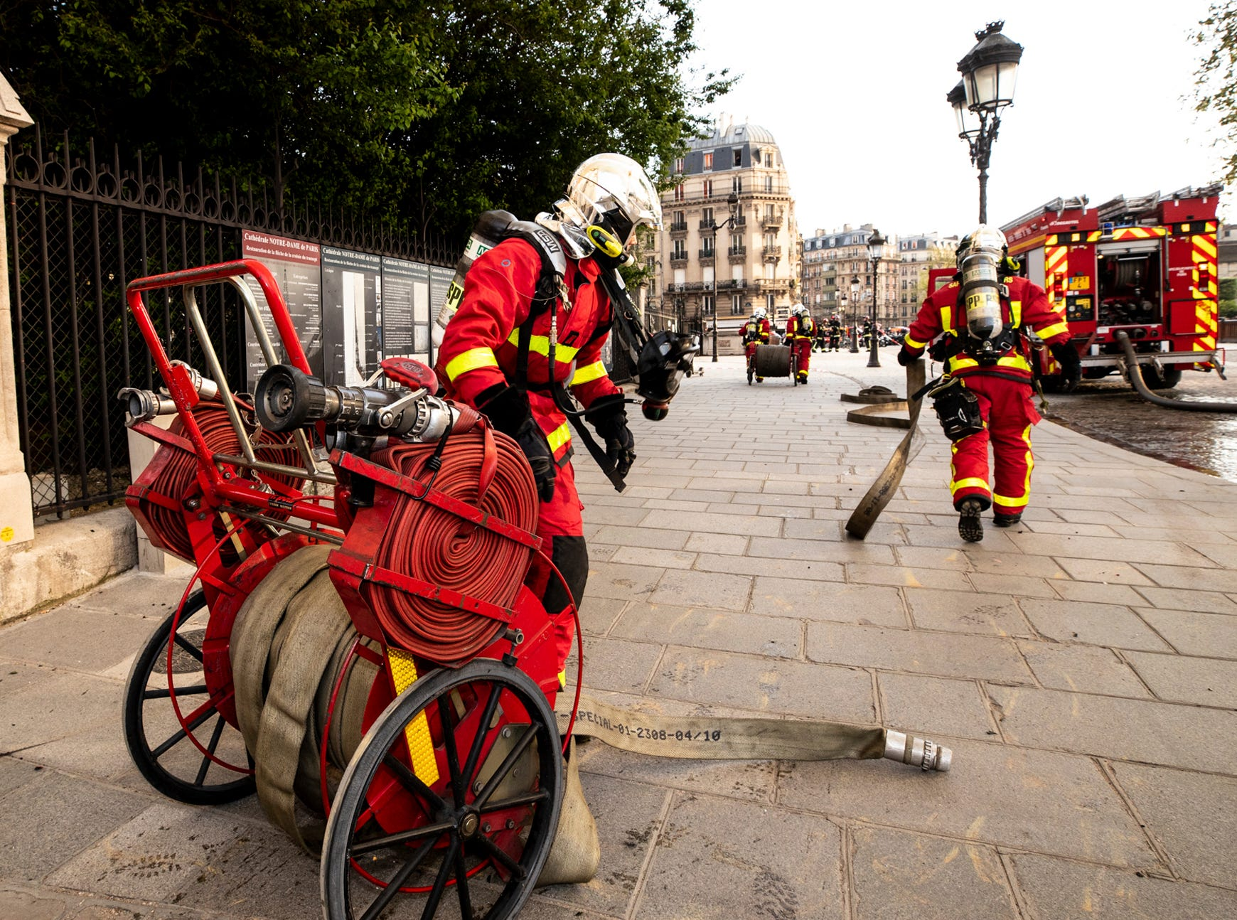 This photo provided Tuesday April 16, 2019 by the Paris Fire Brigade shows fire fighters working at the burning Notre Dame cathedral, Monday April 15, 2019. Experts assessed the blackened shell of Paris' iconic Notre Dame Tuesday morning to establish next steps to save what remains after a devastating fire destroyed much of the cathedral that had survived almost 900 years of history. (Benoit Moser, BSPP via AP)