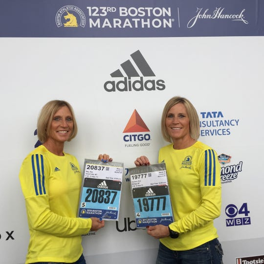 Kim Ray, left, and her twin sister Kris Harrison display their numbers before the start of Monday's 123rd Boston Marathon. Ray is the principal at Loy Elementary School in Great Falls, while Harrison recently moved back to the Electric City. They are natives of Chinook.