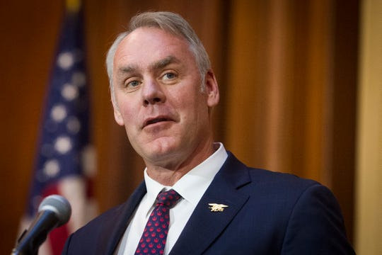 FILE - In this Dec. 11, 2018 file photo, then-Secretary of the Interior Ryan Zinke speaks at EPA headquarters in Washington. Zinke has landed a more than $100,000-a-year job with a Nevada gold-mining firm. Zinke confirmed by phone Tuesday, April 16, he has accepted a consulting and board position with U.S. Gold Corp., a company with business before Zinke's former agency, the Interior Department. (AP Photo/Cliff Owen, File)
