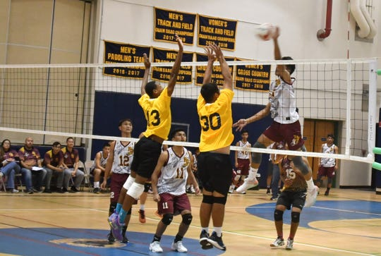 Father Duenas Friars opposite hitter Noah Diaz hits against Guam High during their game March 29 at Guam High.