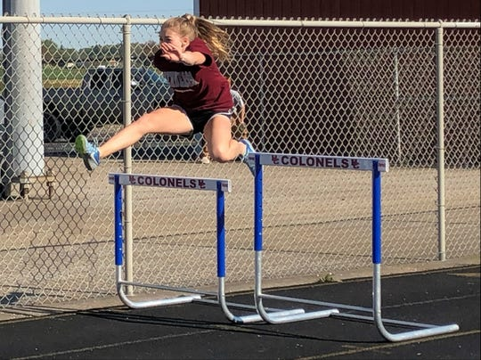 Henderson County sophomore Isabella Tichenor practices the 100-meter hurdles during practice Monday at Colonel Stadium.