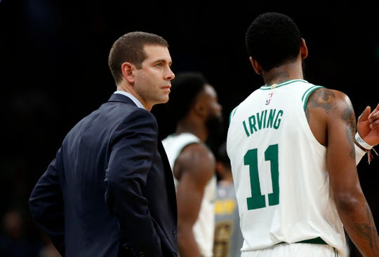 Boston Celtics head coach Brad Stevens spoke with Kyrie Irving during a game against the Indiana Pacers on March 29, 2019, in Boston.