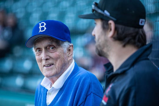 Anderson native and Former Brooklyn Dodgers pitcher, Carl Erskine, age 92, left, and Indianapolis Indians Director of Field Operations Joey Stevenson, right, stand behind home plate at Victory Field on Jackie Robinson Day, Monday, April 15, 2019. Erskine who gave a pre-game interview, was a teammate of Robinson's for nine seasons while playing for the Brooklyn Dodgers from 1948-59.
