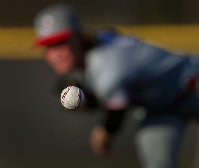 Matt Kryger won Best Sports Action Photo at the Hoosier State Press AssociationFoundation's Better Newspaper Awards for this shot of Southport High School pitcher Avery Short.