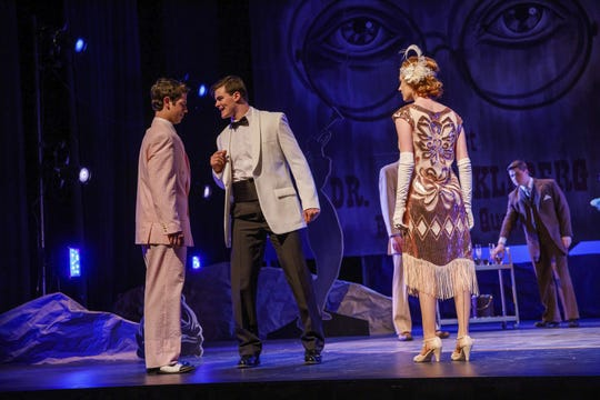 """Notre Dame quarterback J.D. Carney (center) plays the role of Tom Buchanan in a recent campus production of """"The Great Gatsby"""""""