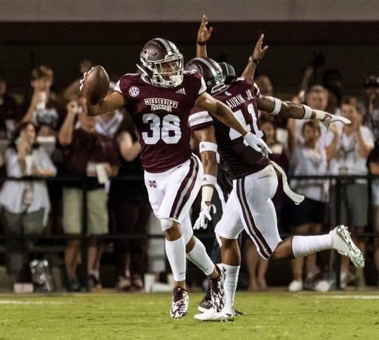 Mississippi State Bulldogs defensive back Johnathan Abram (38) celebrates his interception against the UL Lafayette .