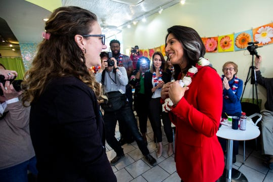 U.S. Rep. Tulsi Gabbard, D-Hawaii, meets with Yotopia owner Veronica Tessler, left, during an event on Tuesday, April 16, 2019, at Yotopia, Iowa City's original frozen yogurt store, along Clinton Street in downtown Iowa City, Iowa.