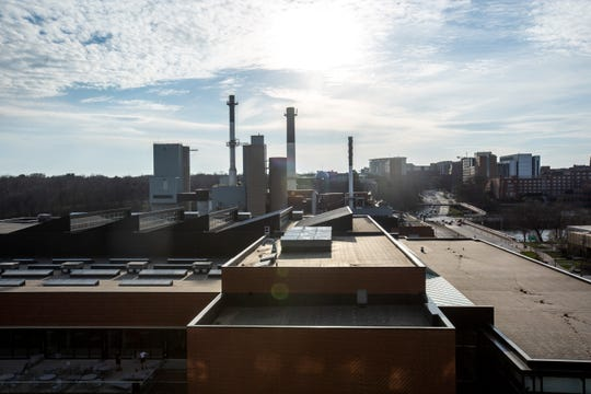 University of Iowa Power Plant is pictured on Monday, April 15, 2019, seen from the rooftop of 316 Madison apartments in Iowa City, Iowa.