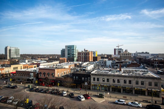 Buildings along Iowa City's skyline are pictured on Monday, April 15, 2019, from the top floor of Phillips Hall in Iowa City, Iowa. From left, Chauncey, hotelVetro, Jefferson Building, The Graduate, and Hilton Garden Inn.