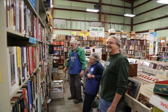 From left, volunteers Bill Mutch, Peg Hampson and Mike Scholtz help preparations for the Friends of the Public Library book sale.
