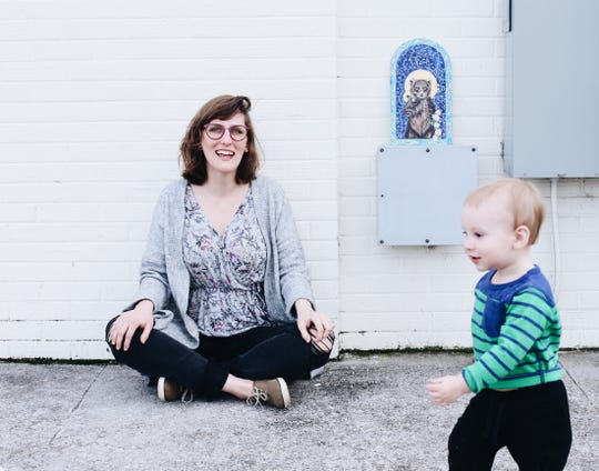 Artist Hannah Bingham, here with her 18-month-old son, Isley, draws a monthly income from Patreon, a crowdfunding platform that operates on a subscription basis.