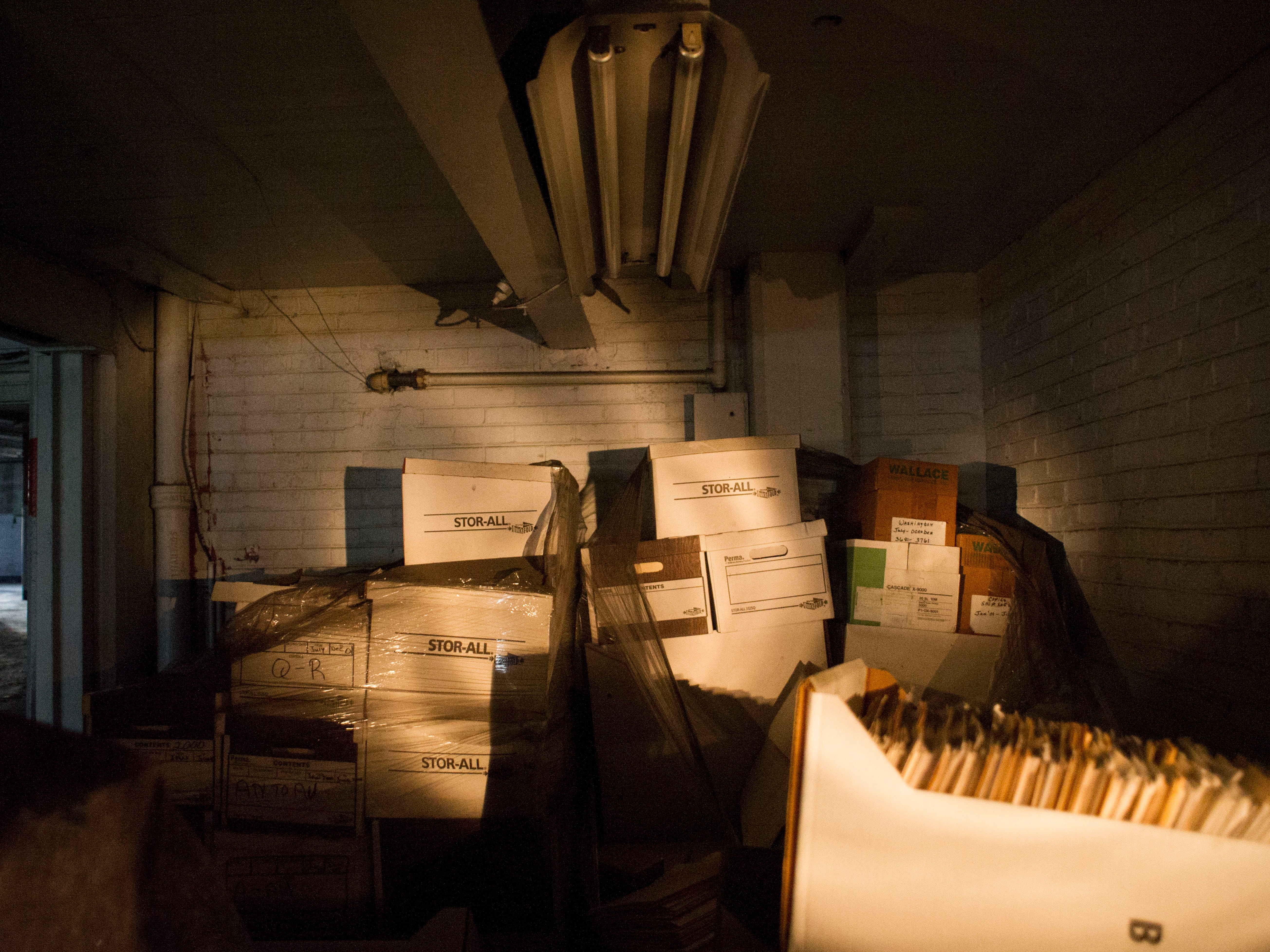 Files fill a storage room at the Standard Knitting Mill building on Thursday, November 15, 2012.