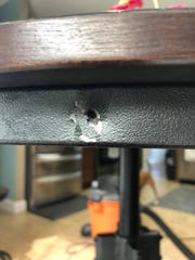 A stray bullet entered Rick Hunley's home late last week, going through a piece of his table and landing on the floor. Hunley said his home is the third in Miller's Plantation subdivision in Karns that this has happened to.
