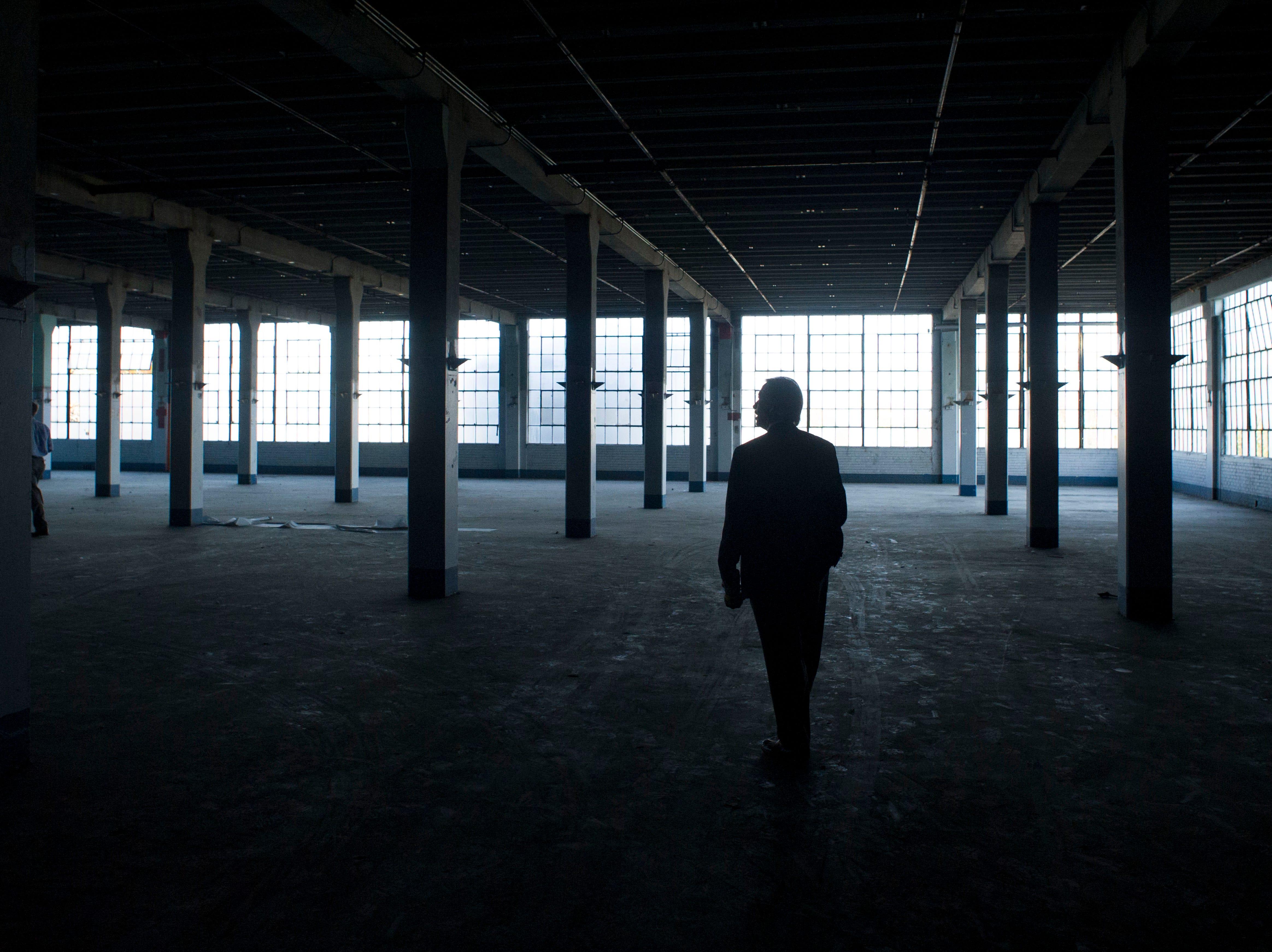 Commercial real estate broker Jim Simpson tours the Standard Knitting Mill building on Thursday, November 15, 2012.